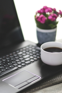 Laptop, flowers, coffee cup